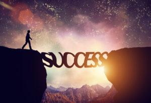 © Michal Bednarek   Dreamstime.com - Man about to walk over precipice on SUCCESS word bridge